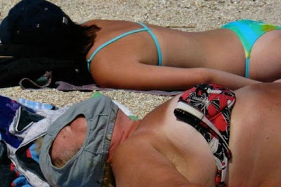 Epic Beach FAIL: There's some things you just shouldn't use for sun protection...we wonder what the SPF rating is...