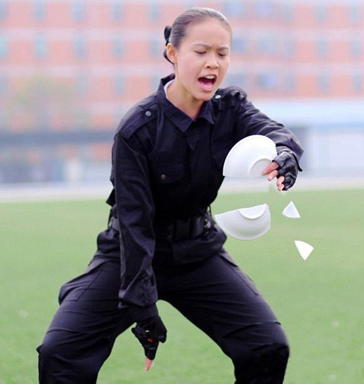"""Pic shows: Flight attendants in one of their courses in hand-to-hand combat to be prepared for in-flight emergencies. Rowdy air passengers better watch their steps and their manners on flights to China in future.  For Chinese flight attendants are now fully trained in unarmed combat to tackle nuisance travellers. Male and female stewards have been put through military-style training to prepare them for in-flight emergencies before graduating from their flight academies. The no-nonsense training has been going on at the aviation vocational school in Chengdu, capital of southwest China's Sichuan Province. And it means the trolley dollys are in peak physical condition having taken courses in hand-to-hand combat before taking to the skies. Undergraduates are put their their paces come rain or shine and learn how to grapple and do somersaults to deal with any situation. One female student Lin Li said: """" We are prepared for anything from a drunk passenger to a terrorist. """"Our military training and taekwondo classes start from year one. They strengthen our bodies and prepare our anti-terrorism abilities and speed of reaction.  """"Besides these classes, we obviously also take etiquette classes as we need to look after and be nice to the passengers so they will feel safe and want to travel with us again."""" Phew, that's okay then. (ends)"""
